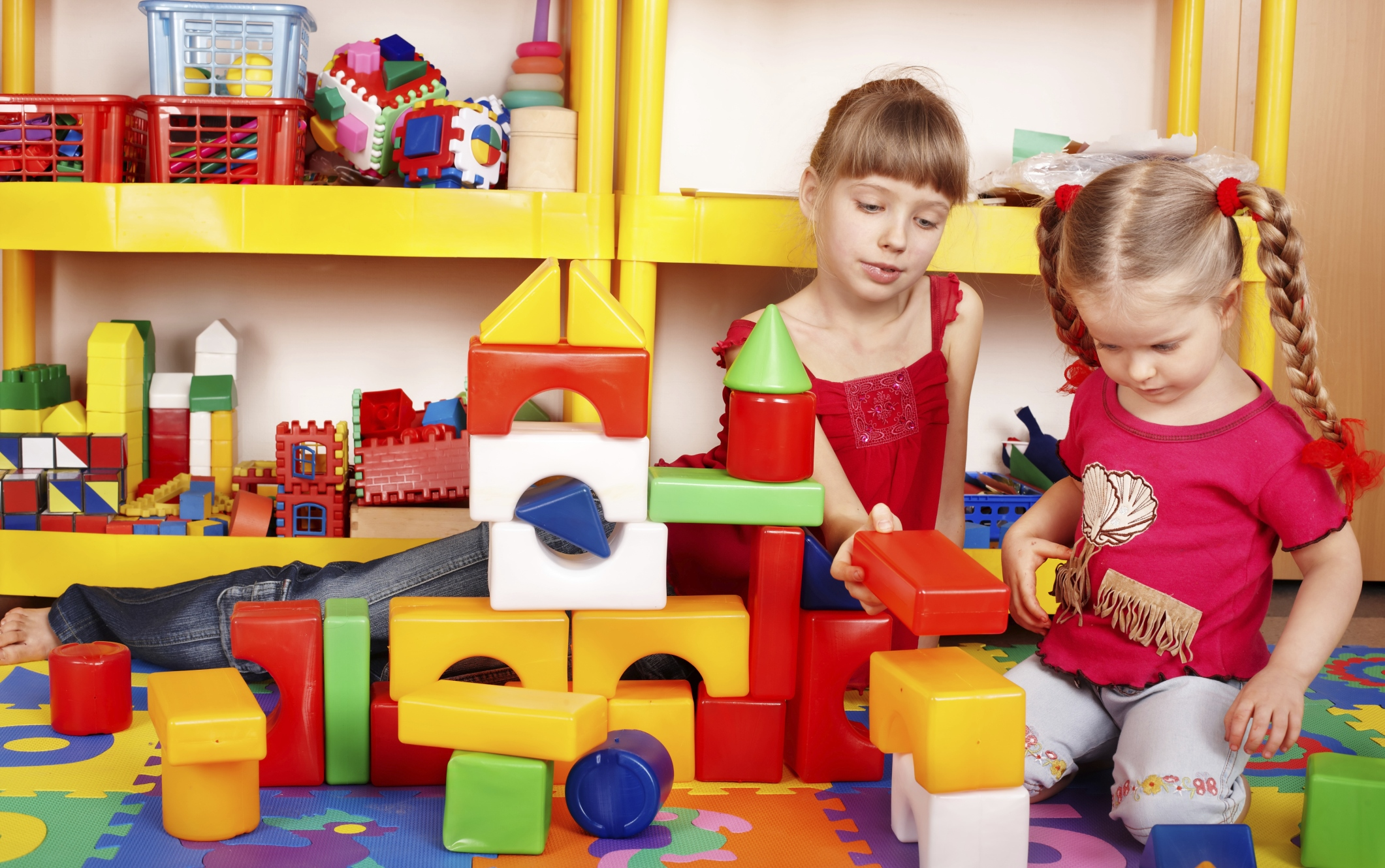 Children  with  block in play room.