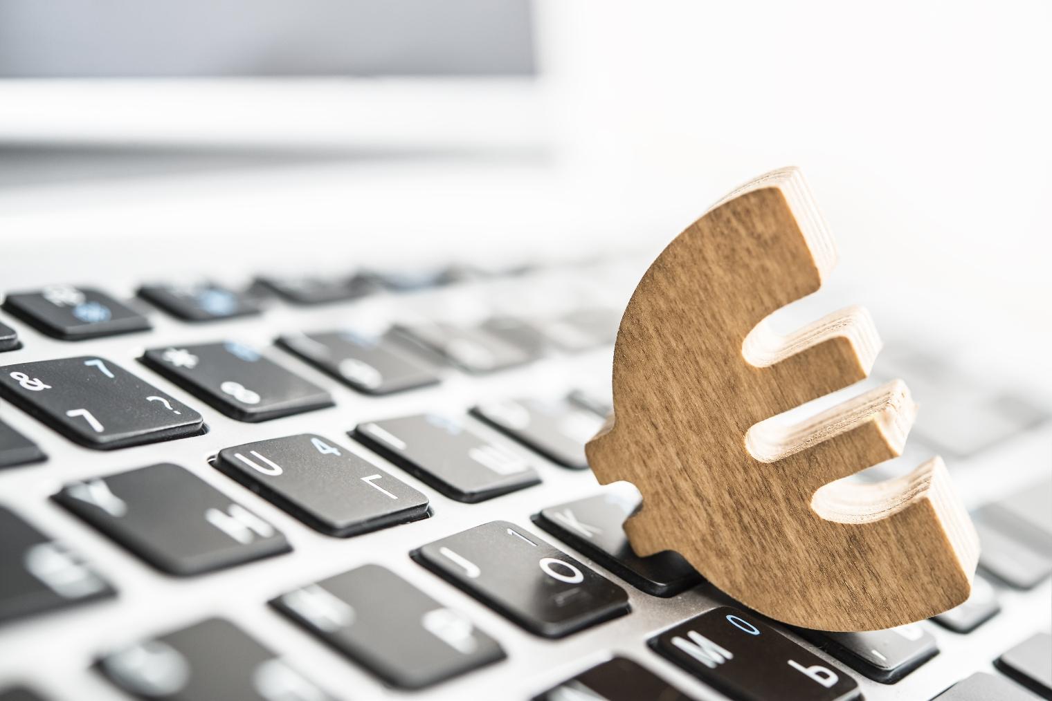 wooden euro sign lie on keyboard of laptop in perspective. financial idea, concept.; Shutterstock ID 438950455; Purchase Order: Digital, Bauschalter, Schlagfertigkeit ; Job: ; Client/Licensee: ; Other: