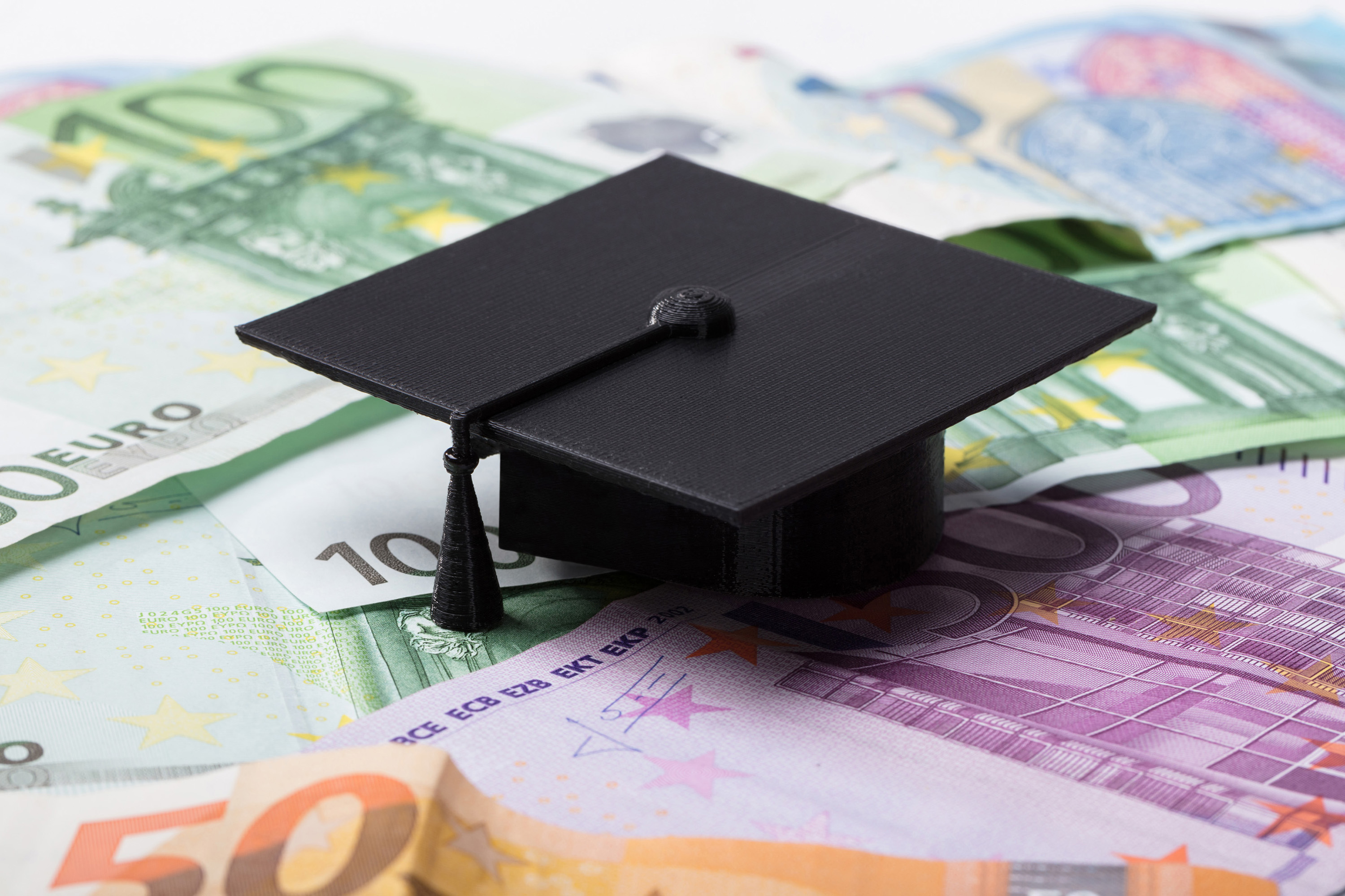 Close-up Of Black Graduation Cap On Euro Banknotes; Shutterstock ID 1032334141; Purchase Order: Leistungsstipendium; Job: ; Client/Licensee: ; Other: